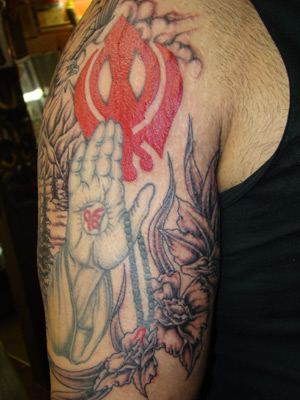 This sikh inspired tattoo was done in two stages. The hands were done first