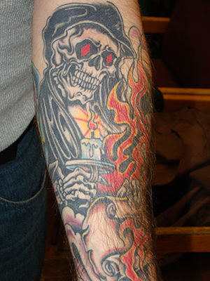 Flaming Skulls Arm Tattoo